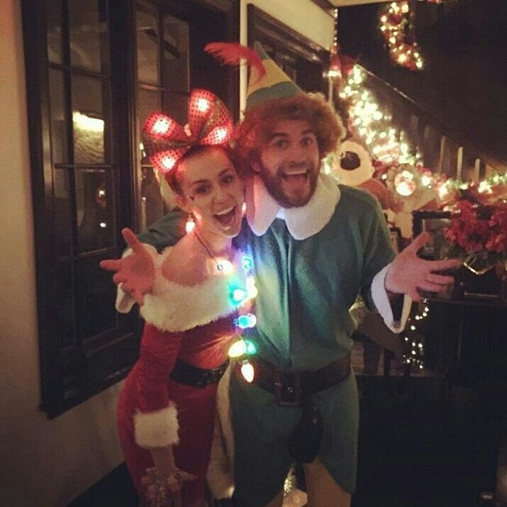 miley cyrus and her fiance liam hemsworth showed off their festive christmas spirit as they dressed as mrs claus and an elf the couple celebrated the - Miley Cyrus Christmas